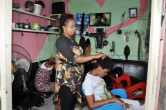 Ariaria-market-Hair-dresser-Nkechi-Benedict-enjoying-the-steady-supply