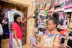 Edaiken-Market-Eloho-Edirin-Trader-showcasing-installations-in-her-shop