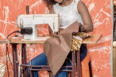 Edaiken-Market-Sarah-Ojekile-Trader-working-with-newly-installed-electric-sewing-machine